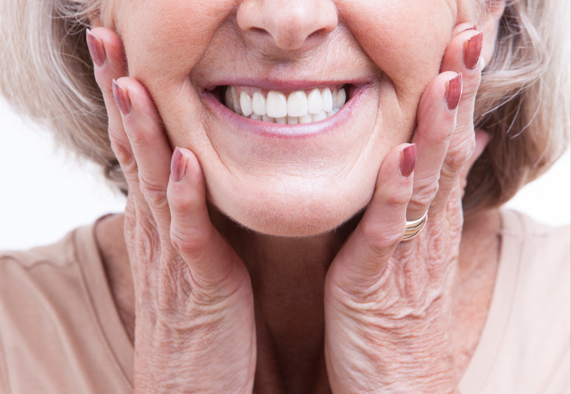 A woman smiling with Dentures in Ann Arbor MI