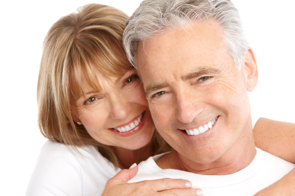 Smiling Couple after getting cosmetic dentistry treatment by their dentist at Embree Dentistry, Ann Arbor Dentist.